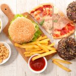 assorted fast food,junk food. 123rf.com. Image credit: margouillat / 123rf. Caption: Trans fat levels in India's foods are to drop dramatically by 2022 as part of a plan to eliminate them from Indians' diets.